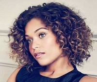 Medium curly bob haircut with natural curls with golden blonde highlights