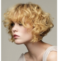 Short bob curly hairdo with long curly bangs.PNG