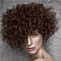 Women small curly hairstyle with long side bang.PNG