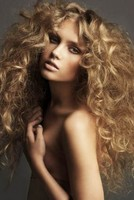 Women tick and lustrious curly hairstyle with a very sexy look.JPG