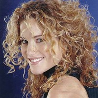 Picture of medium hair style with small curls, blonde