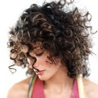 wild medium curls hair cut for women.jpg