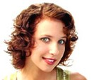 woman curly hairstyle with side bangs.jpg
