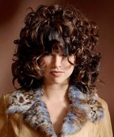 woman full-blown voluminous curls with a dramatic bang for an attention grabbing style with tight curls and choppy bangs.JPG