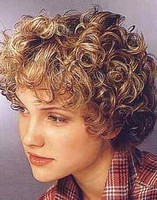 woman short curly hairstyles with big curls.jpg