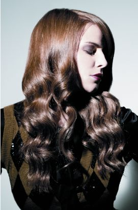 Women Curly Hairstyle Where Part Way Down With The Upper Half All Straight With Long Bangs Fall