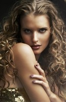 women healthy curly hairstyle with beautiful curls and sultry look.JPG