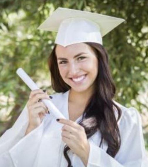 Dark Hair Graduation Hairstyle Under The Beaatiful Graduation Hat In