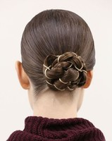 Sleek braided bun with sliver jewelry