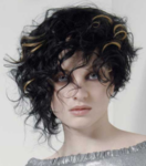 Black curly asymmetrical bob with highlight