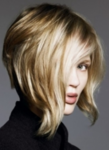 Wavy blonde asymmetrical bob with very long wavy side bangs