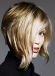 Wavy blonde asymmetrical bob with very long wavy side bangs