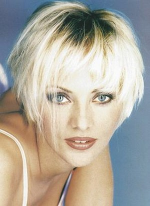 Short Layered Women Hair Cut With Long Bangs In Ice Blonde