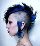 Unique mohawk punk women hairstyle with blue hair color