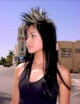 Women long punk hairstyle with very long hair and spiky hair with highlights