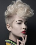 Women newest undercut hairstyle with wavy puffy bang like mohawk with full of waves