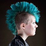 Women punk hairstyle with teal hair colored mohawk haircut