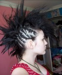 punk women hairstyle with large mohawk in black hair