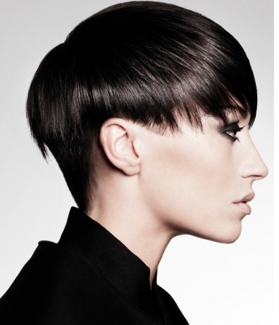 Modern women short hairstyle with long bangs pulled in the front to