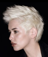 Silver blonde womans short hair with layers and spikes