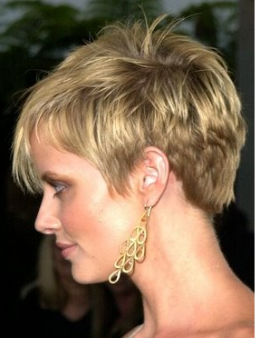 Women boyish haircut with full of layers and spikes with long bangs ...